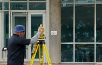 Bill Smith with the FBI uses a 3d imagingin system to map out the crime scene during a guided tour of the path of a shooting and bombing at Dallas Police Department's headquartes on Lamar in Dallas Saturday June 13, 2015.. (Nathan Hunsinger/The Dallas Morning News)(Nathan Hunsinger - Staff Photographer)