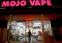 Customer Andrey Perskiy shopped at Mojo Vape, which sells e-cigarette products, in Richardson last week. Perskiy is among those who say they started using e-cigarettes to help them stop smoking.