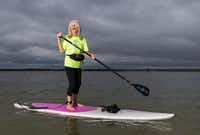 Patty Starkey enjoys stand-up paddle boarding at Lake Grapevine.(Ashley Landis - Staff Photographer)
