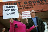 Kathy Carrell and her husband Mike Carrell from Caddo Mills, Texas hold signs in protest of the Northeast Gateway toll road at Hunt County Commissioners Court, Auxiliary Courtroom in Greenville, Texas October 14, 2014. (Nathan Hunsinger/The Dallas Morning News)