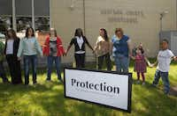 Residents take part in a prayer walk around the Kaufman County Courthouse in Kaufman, Texas on April 14, 2013.  (Michael Ainsworth/The Dallas Morning News)(Michael Ainsworth - Staff Photographer)