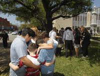 Families pray during a prayer walk around the Kaufman County Courthouse in Kaufman, Texas on April 14, 2013.  (Michael Ainsworth/The Dallas Morning News)(Michael Ainsworth - Staff Photographer)