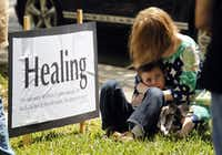 Kristi Ivie of Kaufman prays with her son Lance, 6, during a prayer walk around the Kaufman County Courthouse in Kaufman, Texas on April 14, 2013.  (Michael Ainsworth/The Dallas Morning News)(Michael Ainsworth - Staff Photographer)