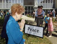 Elaine Blankenship of Kaufman takes part in a prayer walk around the Kaufman County Courthouse in Kaufman, Texas on April 14, 2013.  (Michael Ainsworth/The Dallas Morning News)(Michael Ainsworth - Staff Photographer)