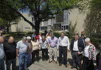 Residents pray during a prayer walk around the Kaufman County Courthouse in Kaufman, Texas on April 14, 2013.  (Michael Ainsworth/The Dallas Morning News)(Michael Ainsworth - Staff Photographer)
