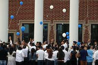 Mourners release memorial balloons after they attended the funeral of 17-year-old Ivan Mejia, at the First Baptist Church of Wylie on Friday. Mejia, a Wylie East High School student was killed by two other students over a dispute over a girl.Michael Ainsworth - Staff Photographer