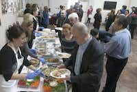 Food is served after services at St. Sarkis Armenian Orthodox Church.(Rex C. Curry - Special Contributor)