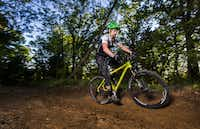 Barry Bishop rides his mountain bike on the North Shore Trail near Lake Grapevine.(Ashley Landis - Staff Photographer)