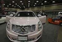 The pink Cadillac is Mary Kay's reward for top sellers. It has been a company signature since Frank Kent Cadillac ordered Mary Kay Ash the '68 Sedan de Ville she wanted in the shade she wanted, even though the color was retired.(Louis DeLuca - Staff Photographer)