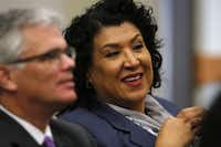 City manager candidate Deanna Santana, with fellow candidate David Cooke at a meeting of the Dallas City Council this week, points to accomplishments in economic development and in stabilizing the city's budget during her time as city administrator in Oakland, Calif.