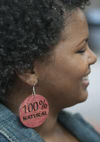Melonee Carter wore earrings describing her chemical-free hair at Saturday's Fro Fest in DeSoto.