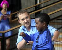 Jeff Swearingen (left), of Fun House Theatre and Film, performed an improv skit with 10-year-old Aaron McLean.
