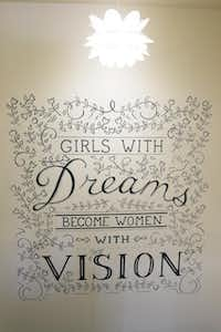 A mural on the wall offers encouraging words for women living at the Ebby House.( Staff photo by MICHAEL REAVES   -  DMN )