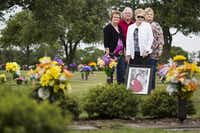Members of Alan Nevil's family, from left, sister Fran Cawley, brother Ricky Nevil, Sr., mother Dorothy Nevil, and sister in law Charlotte Nevil at the gravesite of Alan Nevil and his wife Darlene. Alan Nevil and his wife were killed by Darlene's 12-year-old daughter and her 13-year-old boyfriend in August 2010. According to a court ruling Wednesday, the boy will be paroled before his 19th birthday next month. (Smiley N. Pool/The Dallas Morning News)