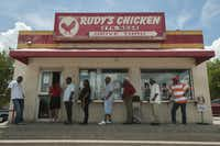 Customers line up to order from Rudy's Chicken on South Lancaster Road.  The city is investing $890,000 in bond money to help owner Rudolph Edwards replace the shack with a new, double drive-through building on an empty lot next door.