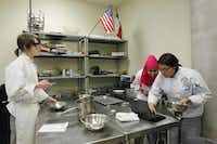 Caleb Helms, Sumaya Mohamud (center) and Yatziri Bravo work in the culinary arts classroom at Dubiski. Grand Prairie has seen passing rates rise and had 735 students transfer into the district from area schools this year.( Mona Reeder  -  Staff Photographer )