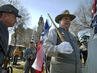 Sons of Confederate Veterans, including Michael Lee Garrett, right, wait for the Fort Worth Stock Show and Rodeo All Western Parade to begin in downtown Fort Worth Saturday January 18, 2014. (Ron Baselice/ The Dallas Morning News)(Ron Baselice - Staff Photographer)
