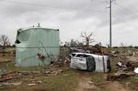 A tornado with winds up to 200 mph Wednesday left debris across the Rancho Brazos neighborhood near Granbury.  Six people were killed and dozens were injured in storms that night.
