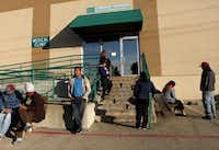 People wait  outside North Dallas Shared  Ministries. Early next year, the Adult Dental Clinic will expand its ser vice from five days a month to five days a week.(Sarah Hoffman)