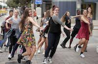 """A """"flash mob"""" of Booker T. Washington students dances at DART's Akard Station downtown to promote North Texas Giving Day. A lot of hard work goes into the event, Communities Foundation of Texas officials say; this year's is Sept. 18.File 2013 - Staff Photo"""
