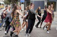 """A """"flash mob"""" of Booker T. Washington students dances at DART's Akard Station downtown to promote North Texas Giving Day. A lot of hard work goes into the event, Communities Foundation of Texas officials say; this year's is Sept. 18.(File 2013 - Staff Photo)"""
