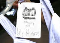 The graduation dress  came with Lily Ramirez's name on it, but she was among those seeking alternatives. She said Hockaday headmistress Kim Wargo seemed sympathetic but did not support the change. Wargo has since resigned.(David Woo - Staff Photographer)