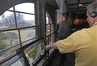 John Shearer (left) of California and Gary Valko of Denver checked out the view from a window overlooking Dealey Plaza at the Sixth Floor Museum on Wednesday. An interactive video allows visitors to follow the path of President John F. Kennedy's motorcade.( Michael Ainsworth )