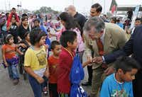 Dallas Mayor Mike Rawlings greeted families at the start of the Back-to-School Fair. The event provided free health checks, dental exams, vision screenings, immunizations, haircuts and school supplies.David Woo  -  Staff Photographer
