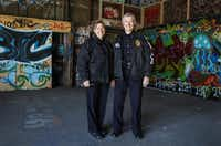 Dallas police Lt. Sally Lannom (right), with Sgt. Cheryl Cornish, hopes the West Dallas freewall building might steer taggers into art careers.(Jim Tuttle - Staff Photographer)