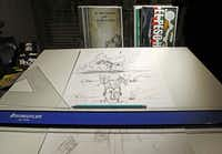Work in progress on El Peso Hero's story covers the drawing table at Hector Rodriguez's apartment in Dallas.