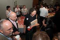 Arny Felner (second from left) with Congregation Beth Torah and Rev. Debra Hobbs Mason mingled after they gave presentations on compassion during an Interfaith service at First United Methodist Church in Richardson on Nov. 20, 2014.( Photo by Rex C. Curry )