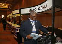 Kansas City Mayor Sly James, checks in,  during the U.S. Conference of Mayors at the Omni Hotel in Dallas,  on June 20, 2014. (Michael Ainsworth/The Dallas Morning News)Michael Ainsworth - Staff Photographer