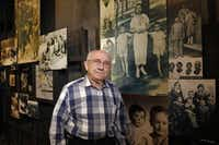 Max Glauben stands in front of some of the photographs taken of his family in Poland and displayed at the Dallas Holocaust Museum/Center for Education.( David Woo )