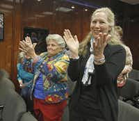 Retired state Rep. Harryette Ehrhardt (left) and Kyle Renard cheered after the Dallas ISD commission voted Tuesday not to create a home-rule charter.Nathan Hunsinger  -  Staff Photographer