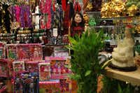 "Yanna Liu looks after her store, Arts and Gift Collection, at the Cali Saigon Mall in Garland. ""Now we are 100 percent full,"" said mall manager Huy Trieu. ""People are calling to see if we have any extra space."""