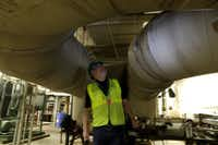 Contractor Danny Moran oversees the energy system installation in the boiler room at the George L. Allen Sr. Courts Building in Dallas.