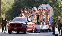BJ's NXS float rolls down Turtle Creek Blvd during the Alan Ross Texas Freedom Parade on Cedar Springs Rd. in Dallas, Sunday, September 21, 2014. The gay, lesbian, bisexual and transgender parade had over 80 entries. (Tom Fox/The Dallas Morning News)(Tom Fox - Staff Photographer)