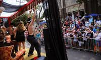 Performers on the Casa Blanca Burlesque float entertain the crowd in the Alan Ross Texas Freedom Parade on Cedar Springs Rd. in Dallas, Sunday, September 21, 2014. The gay, lesbian, bisexual and transgender parade, which had over 80 entries, ended at Lee Park. (Tom Fox/The Dallas Morning News)(Tom Fox - Staff Photographer)