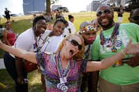 A group of spectators pose for a photo during the Alan Ross Texas Freedom Parade on Cedar Springs Rd. in Dallas, Sunday, September 21, 2014. The gay, lesbian, bisexual and transgender parade, which had over 80 entries, ended at Lee Park. (Tom Fox/The Dallas Morning News)(Tom Fox - Staff Photographer)