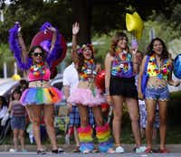 A group of spectators cheer during the Alan Ross Texas Freedom Parade on Cedar Springs Rd. in Dallas, Sunday, September 21, 2014. The gay, lesbian, bisexual and transgender parade, which had over 80 entries, ended at Lee Park. (Tom Fox/The Dallas Morning News)(Tom Fox - Staff Photographer)