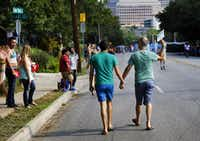 A couple walks to the festival in Lee Park after attending the Alan Ross Texas Freedom Parade on Cedar Springs Rd. in Dallas, Sunday, September 21, 2014. The gay, lesbian, bisexual and transgender parade had over 80 entries. (Tom Fox/The Dallas Morning News)(Tom Fox - Staff Photographer)