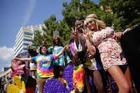 A group of people on the Caven Enterprises float pose for a photo during the Alan Ross Texas Freedom Parade on Cedar Springs Rd. in Dallas, Sunday, September 21, 2014. The gay, lesbian, bisexual and transgender parade, which had over 80 entries, ended at Lee Park. (Tom Fox/The Dallas Morning News)(Tom Fox - Staff Photographer)