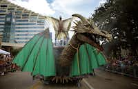 Mateo Vences spreads his wings atop a large dragon on the Club Kaliente float in the Alan Ross Texas Freedom Parade on Cedar Springs Rd. in Dallas, Sunday, September 21, 2014. The gay, lesbian, bisexual and transgender parade, which had over 80 entries, ended at Lee Park. (Tom Fox/The Dallas Morning News)(Tom Fox - Staff Photographer)