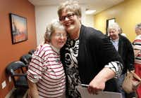 Patty Covell, left, of Richardson, hugs with Debbie Childre, cq, the director of Seniors' Net of Network of Community Ministries, Inc., as she visits to the center for the Loaves of Love event. Loaves of Love is twice a week event to give seniors some free bread.( Kye R. Lee )