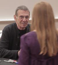 Leonard Nimoy met a young fan as he signed autographs at Dallas Comic Con on Saturday.