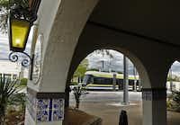 A DART streetcar passes in front of El Fenix near the Beckley Avenue stop in Oak Cliff. A southward expansion of the streetcar line is planned for later this year. And a connecting shuttle bus service around the Bishop Arts District is planned after that.(2015 File Photo -  Staff  )