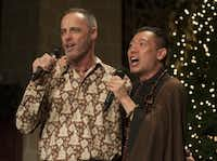 Singers Gary Floyd (left) and Brother ChiSing lent their voices to festivities as more than 900 people gathered for the last celebration of a 20-year Dallas tradition.