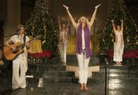 Standing yoga postures accompanied by guitar welcomed the winter solstice Friday at the Cathedral of Hope.