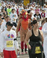 Participants in the YMCA Turkey Trot make their way down Elm St. on Thursday, Nov. 22, 2012.