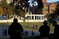 As the sun set, people gathered at the grassy knoll at Dealey Plaza for the anniversary of the JFK assassination last Nov. 22.